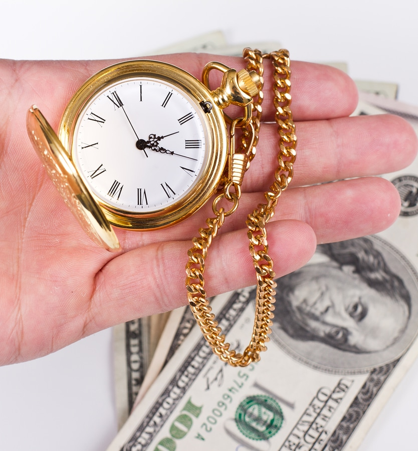 bigstock Hand Time And Money