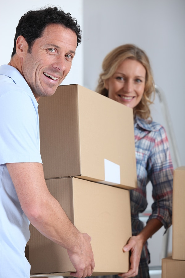 bigstock Couple moving pile of boxes