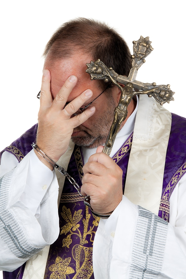 bigstock Catholic Priest With Handcuffs