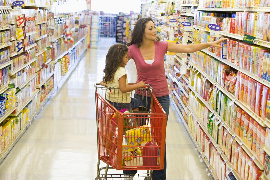 bigstock Woman And Child With Trolley I