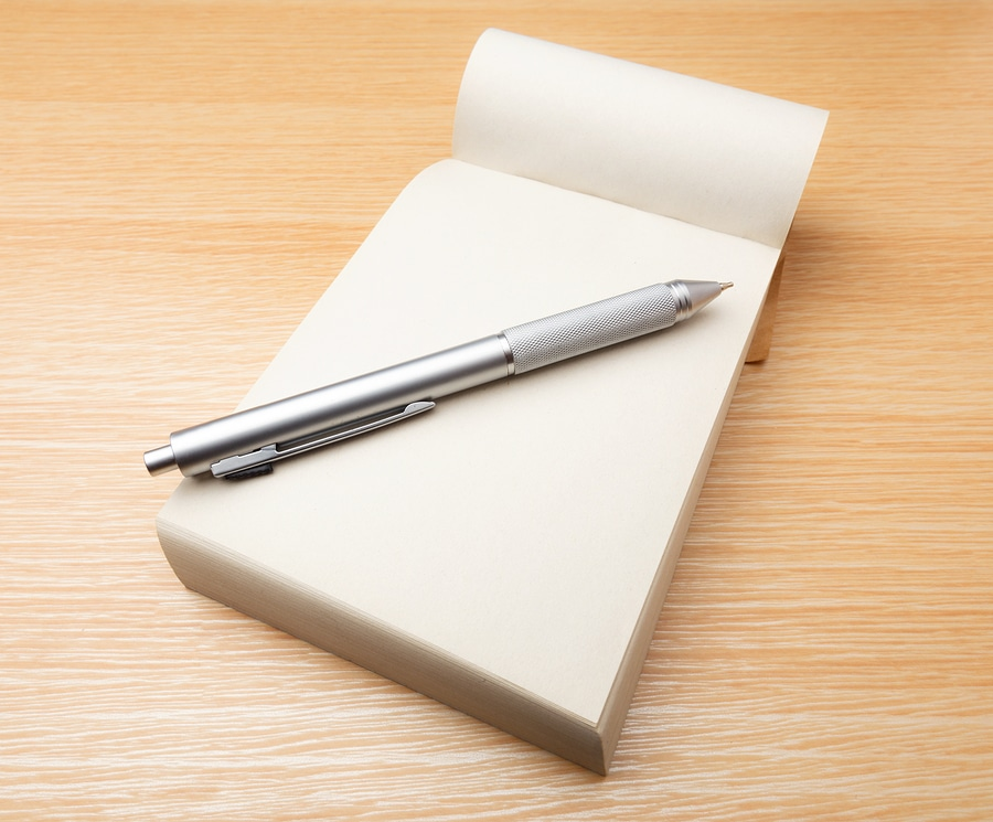 bigstock Memo pad and pen on the table