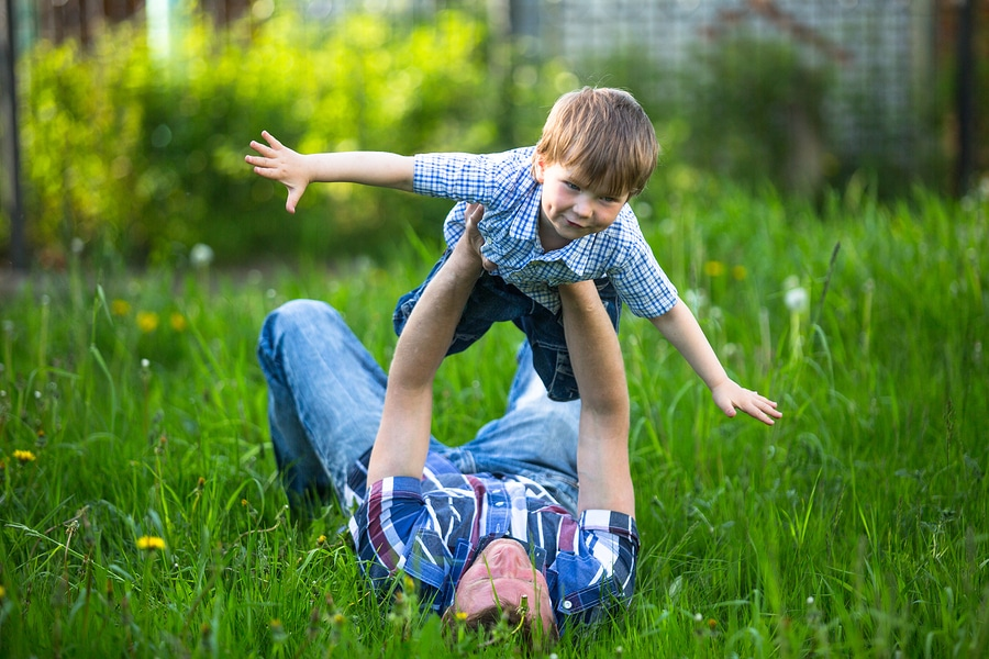 bigstock Father and son playing lying o