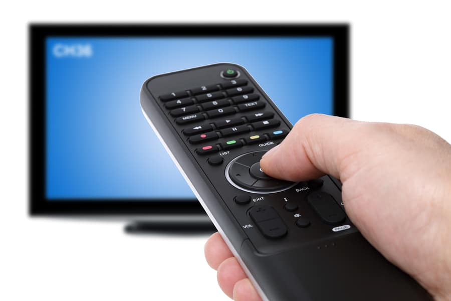 bigstock Hand using tv remote control t