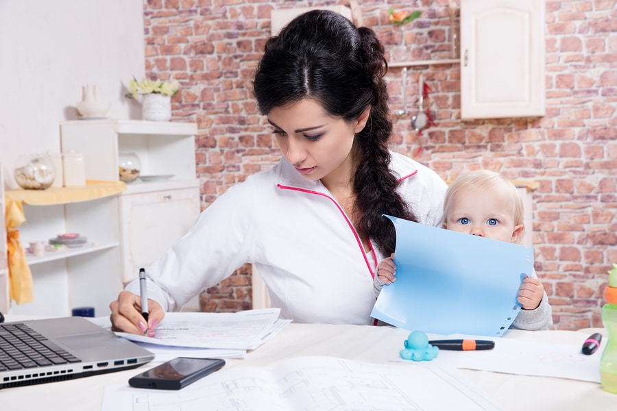 bigstock Woman With Baby Working From H