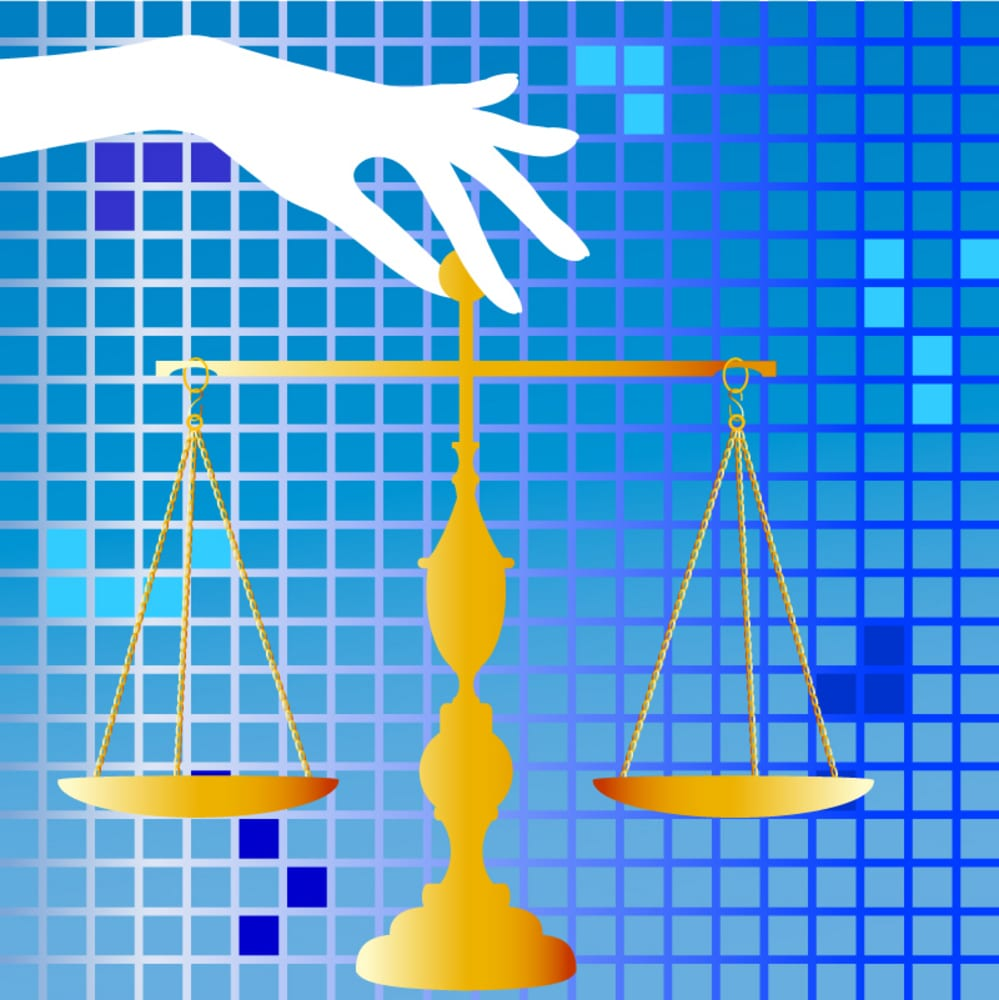 bigstock scales of justice held by hand