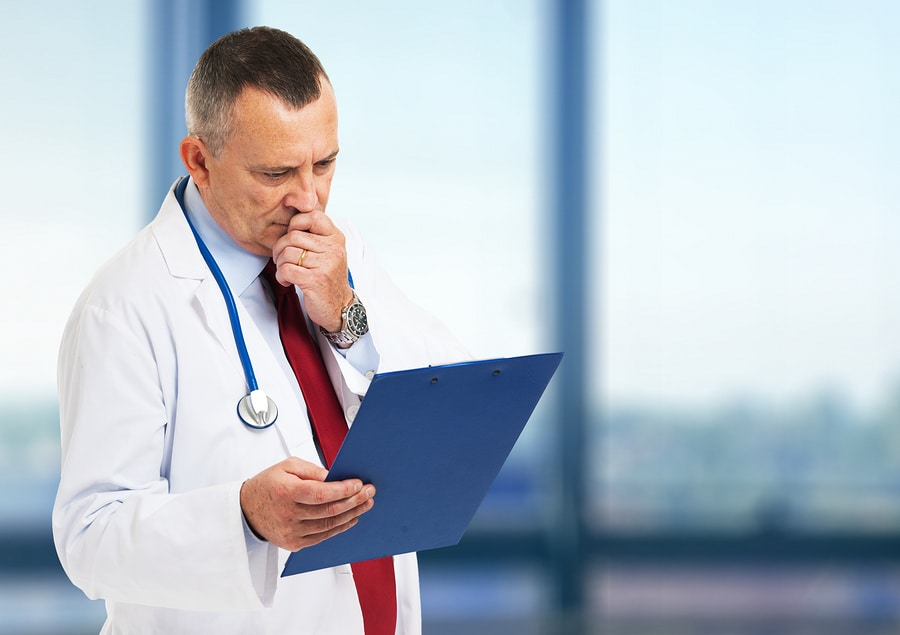 bigstock Senior doctor reading a case h
