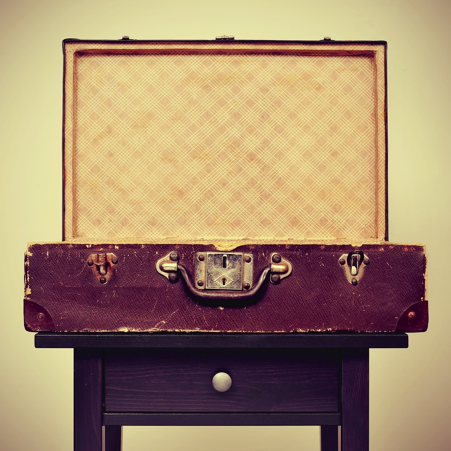 bigstock an open old suitcase on a tabl