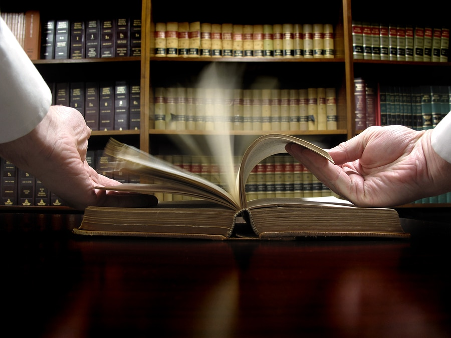 bigstock Hands turning pages in old law