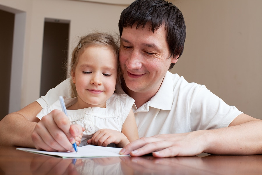 bigstock Father helping daughter doing