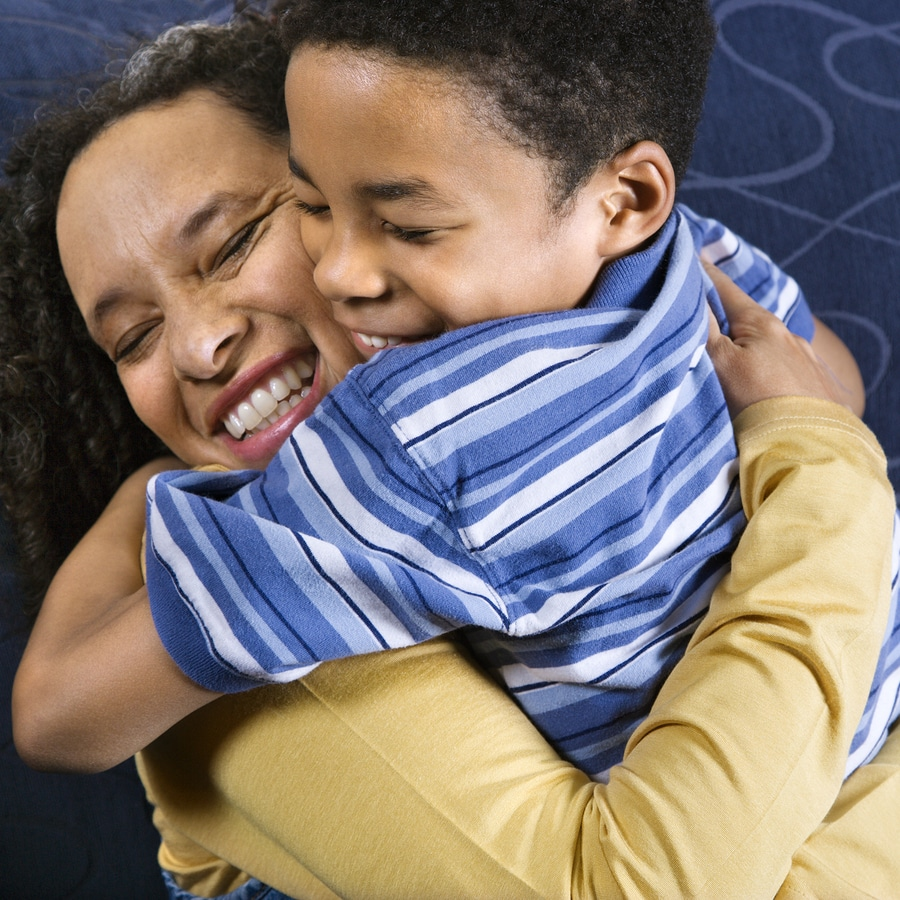 bigstock Woman Hugging Son