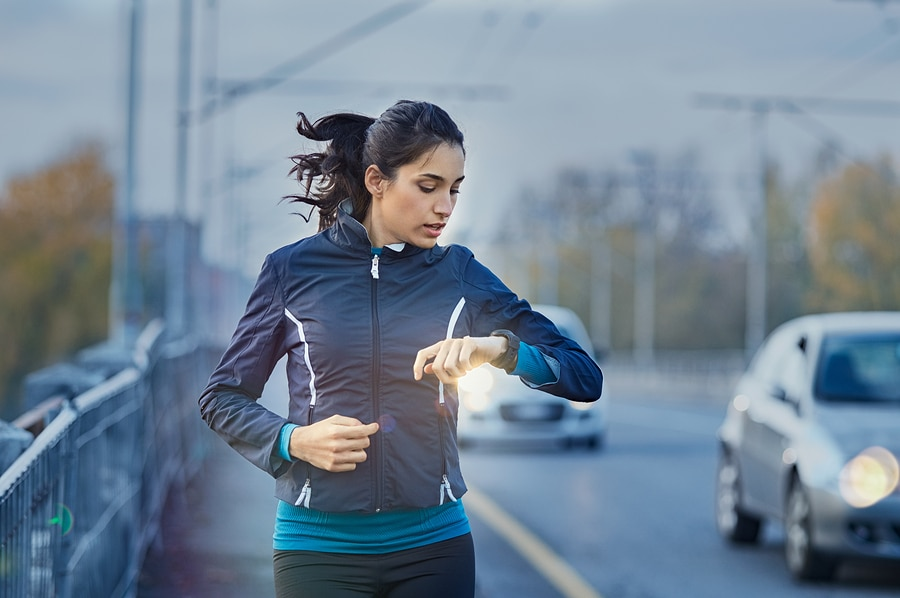 running with smartwatch and cars