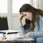 woman stressed with finances bills