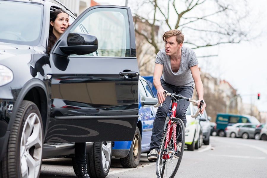 bicyclist and car on street