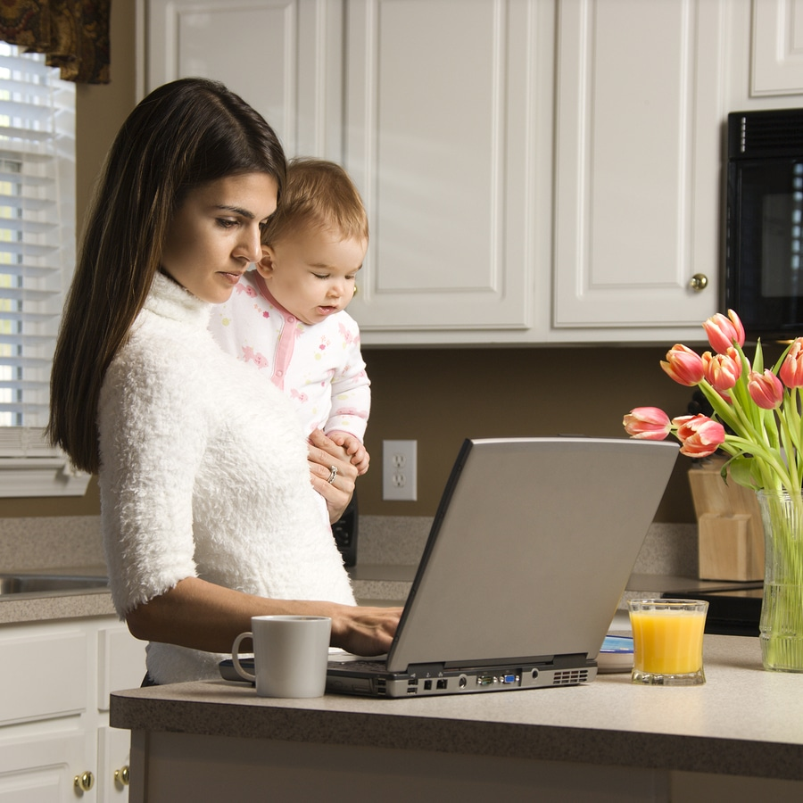 woman on computer with baby
