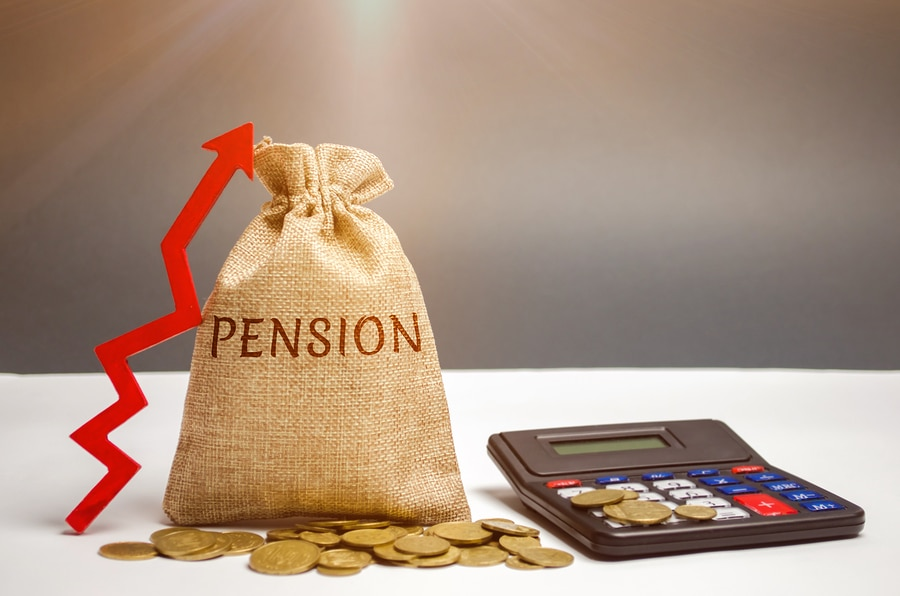 pension written on bag with money and calculator