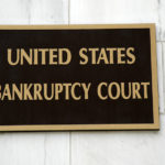 United States Bankruptcy Court sign on wall
