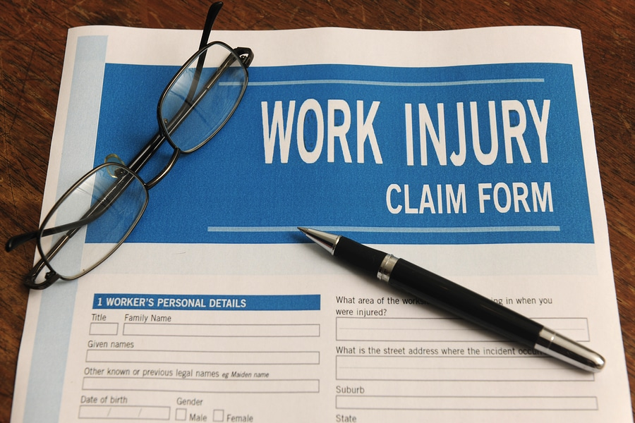 work injury claim form pen glasses