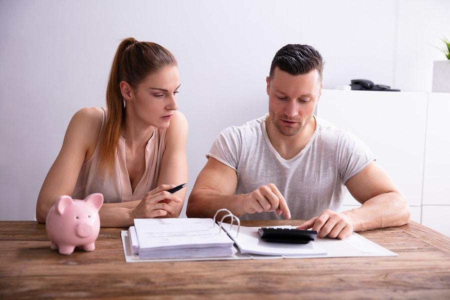 bigstock Couple Calculating Bills Using