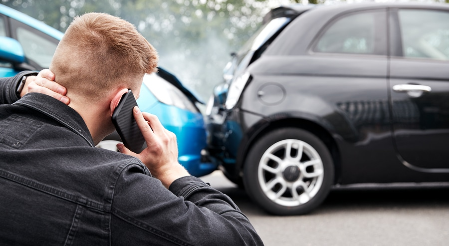 man on phone car crash