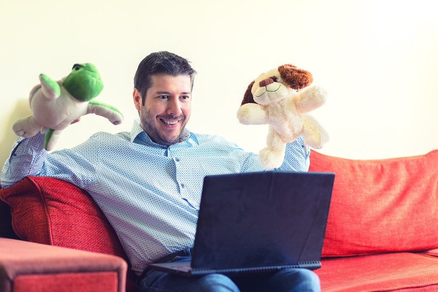 man video chat with computer and puppets