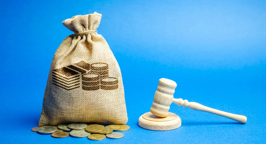 money bag coins and gavel