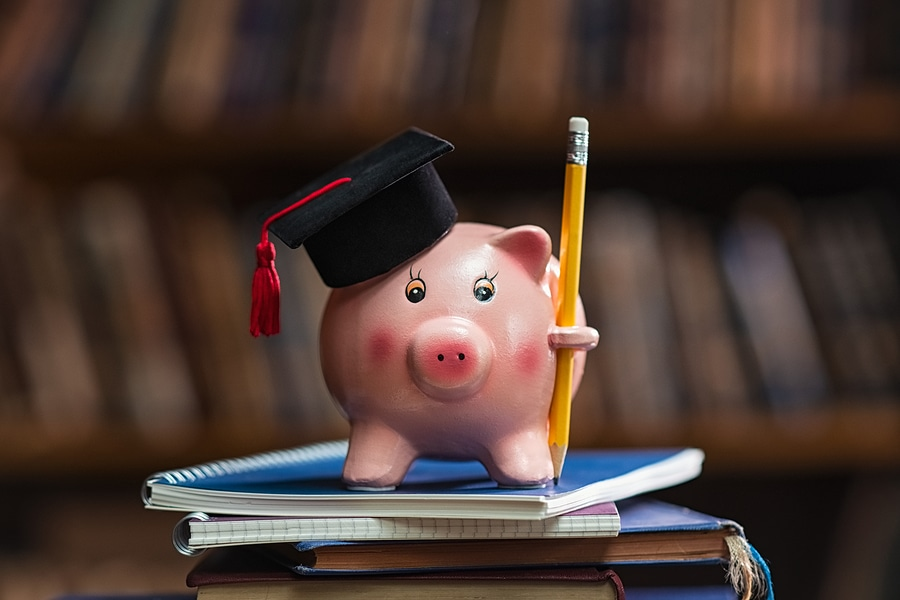 bigstock Pink piggy bank wearing gradua