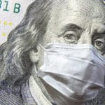 money bill with face mask