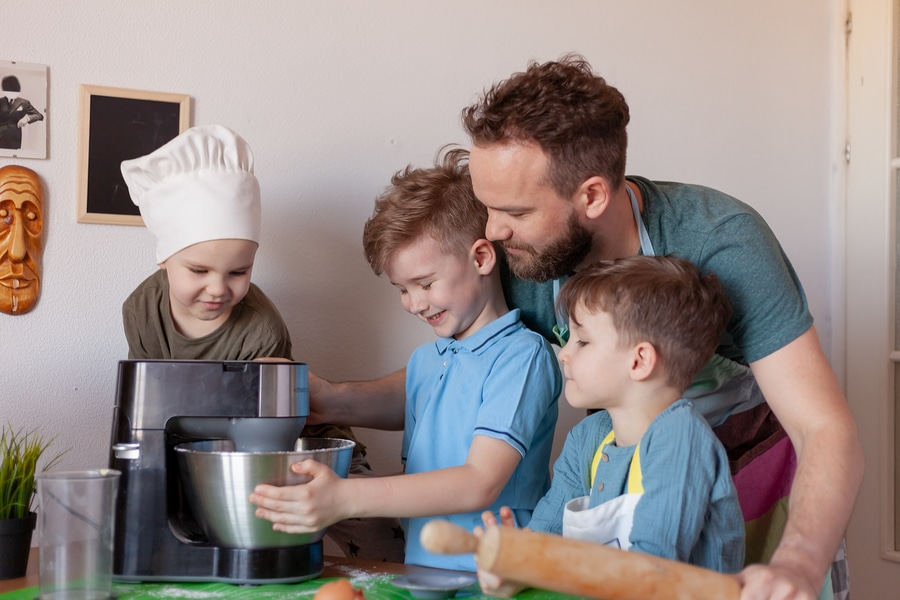 father with children in kitchen